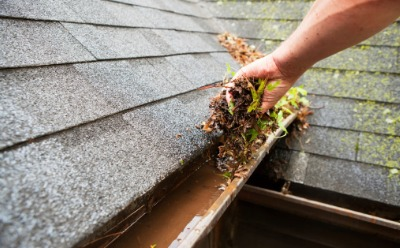 Man performing Gutter Cleaning in Peoria IL