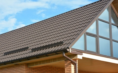 The roof of a home with newly installed gutters and Gutter Guards in East Peoria IL